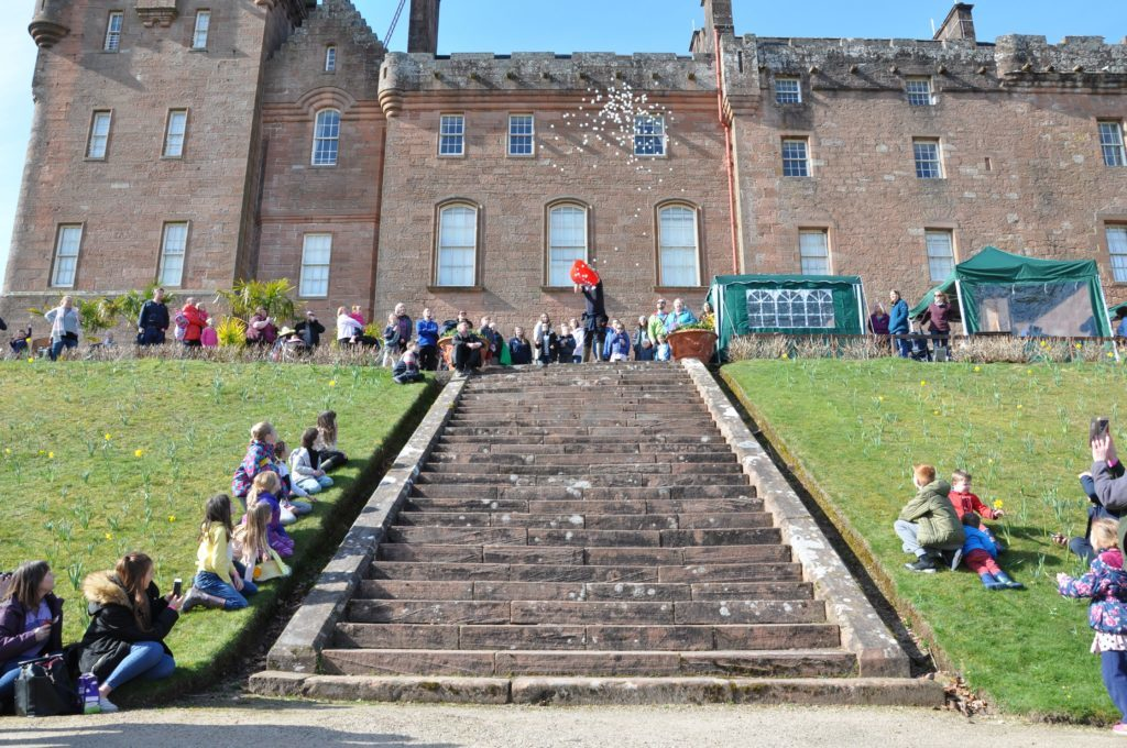 An unusual duck derby - balls are launched off the stairs at Brodick Castle