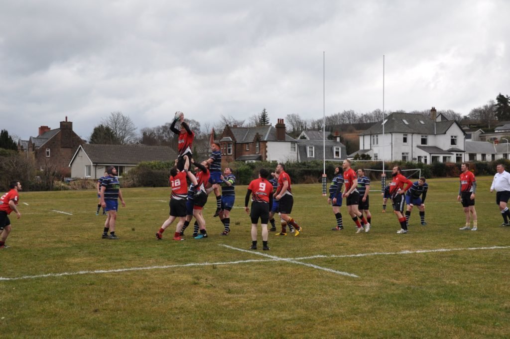 Arran hoists a player into the air to gain possession during a line out