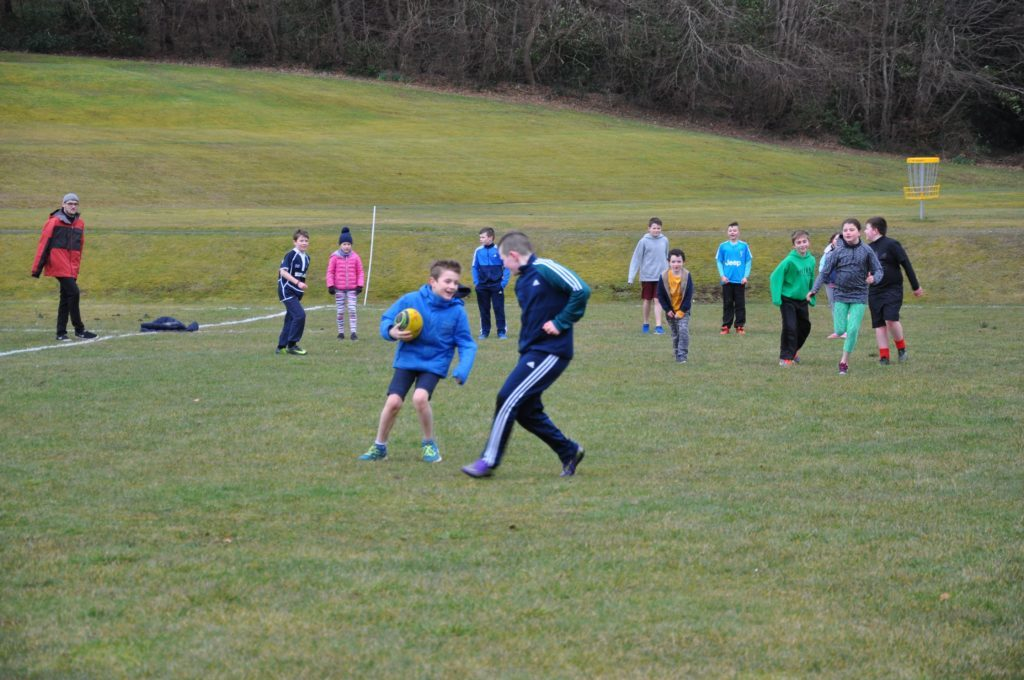 The next generation of young rugby players practise their ball control skills