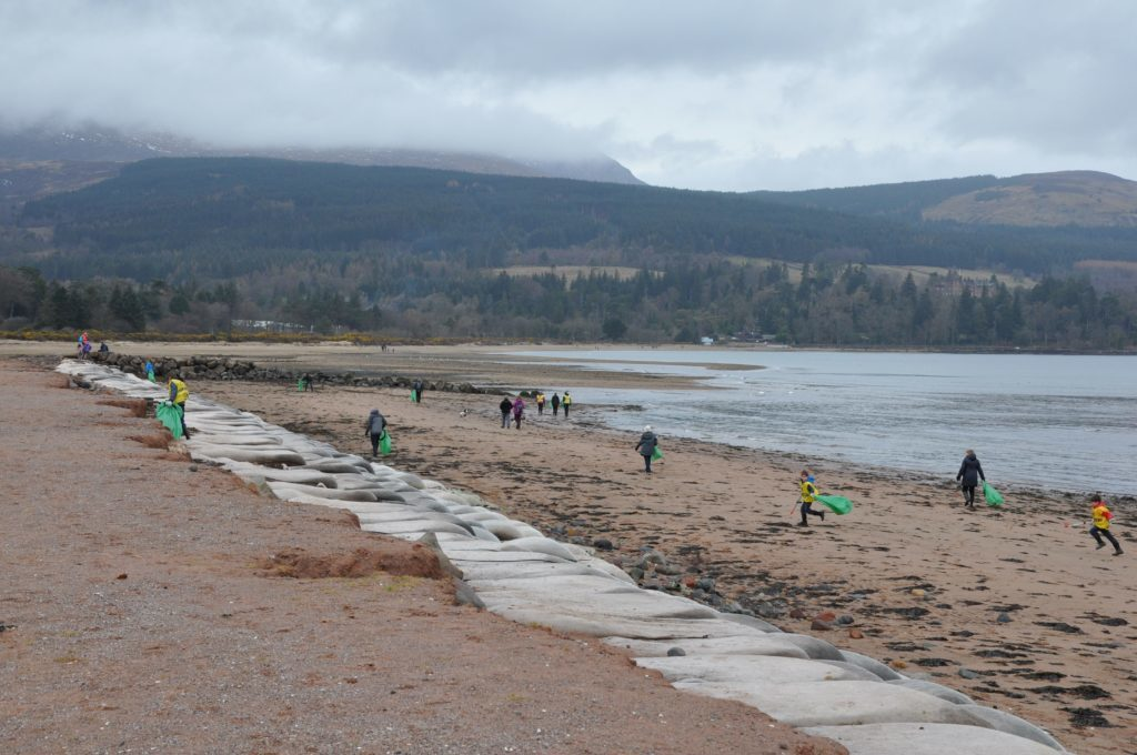 Leaving no stone unturned, volunteers scour the beach for any discarded or washed up litter