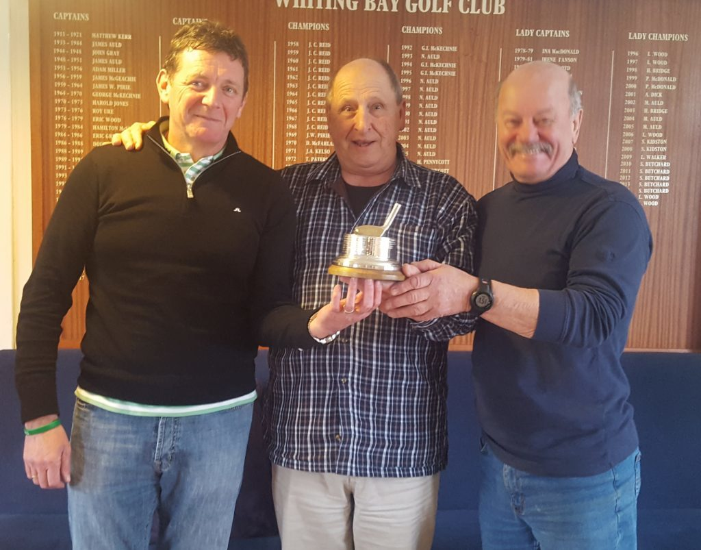 ​Captain Wolfi Kroner presents the Tor Alvey trophy to winners Kevin McAleney and Ronnie Mann.