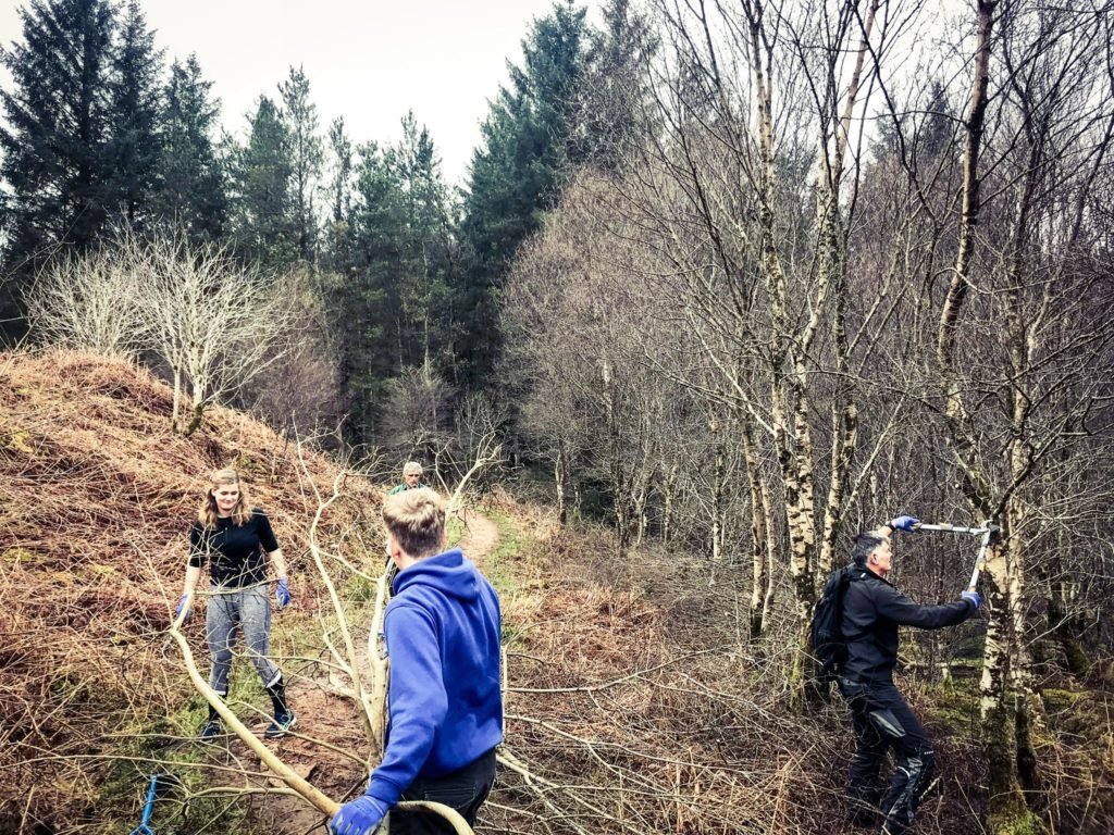 Volunteers remove overgrown bushes and overhanging branches which caused obstructions on the pathways