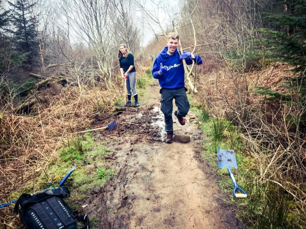 Mountain bike club members set to work on a waterlogged section of the trail.