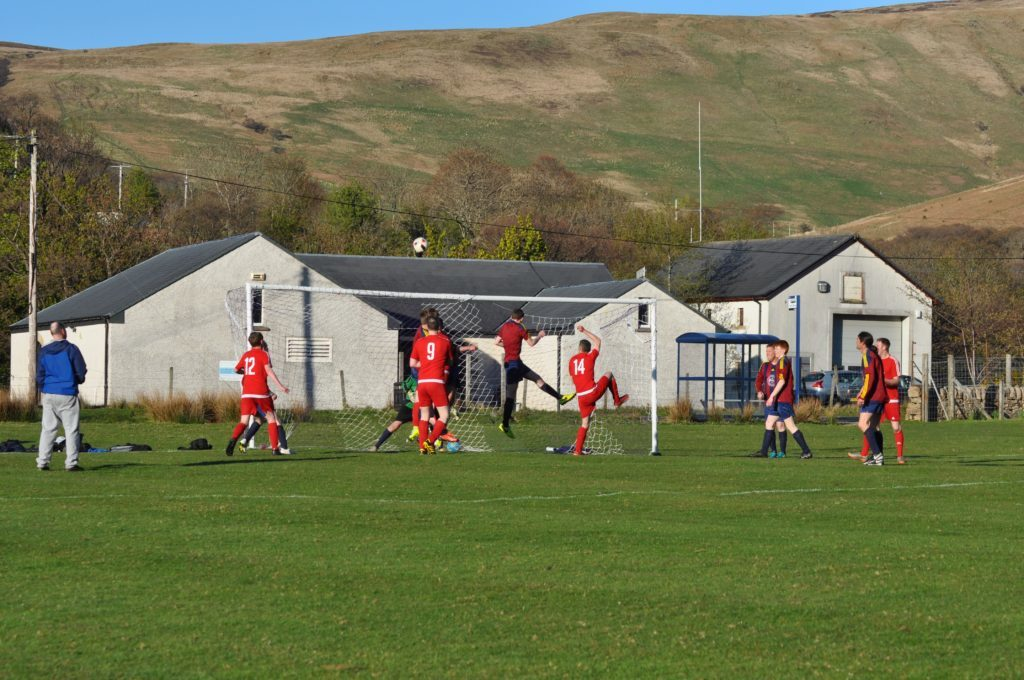 A Shiskine attempt at goal from the corner of the pitch goes high.