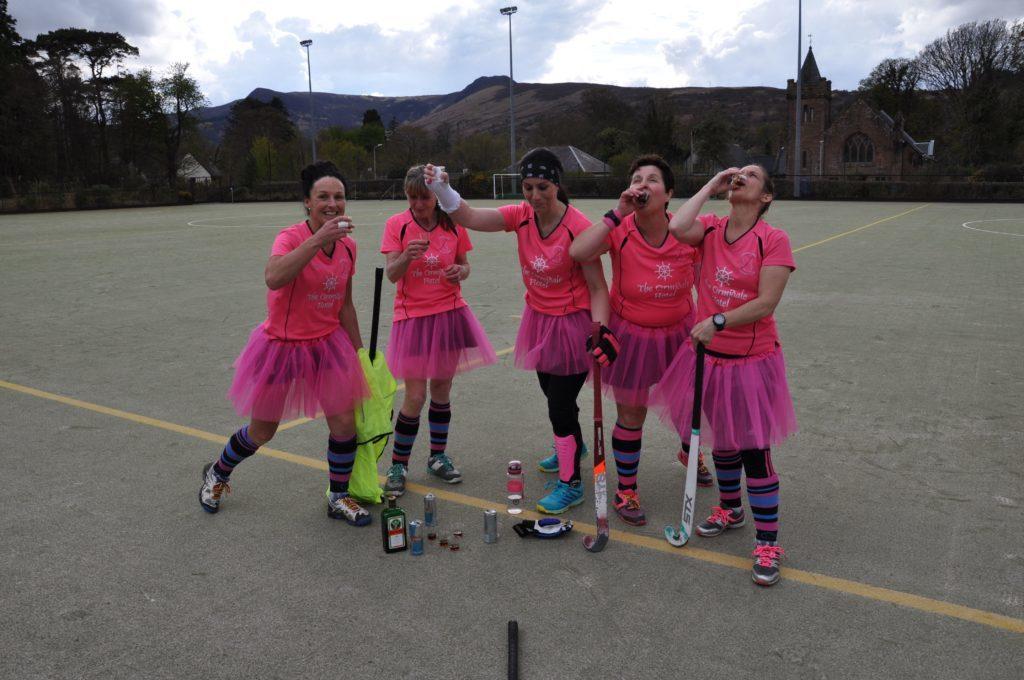 Arran Ladies enjoy a post game celebratory shot.
