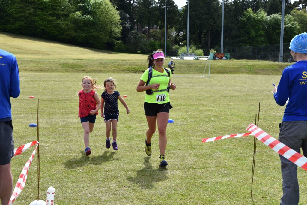 Arran Fell Runner, Michelle Williamson is joined by her two daughters over the finish line.