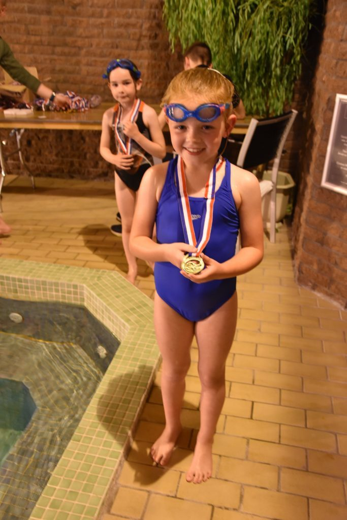 Isla McKinnon proudly shows off her first place medal in the P2 category.