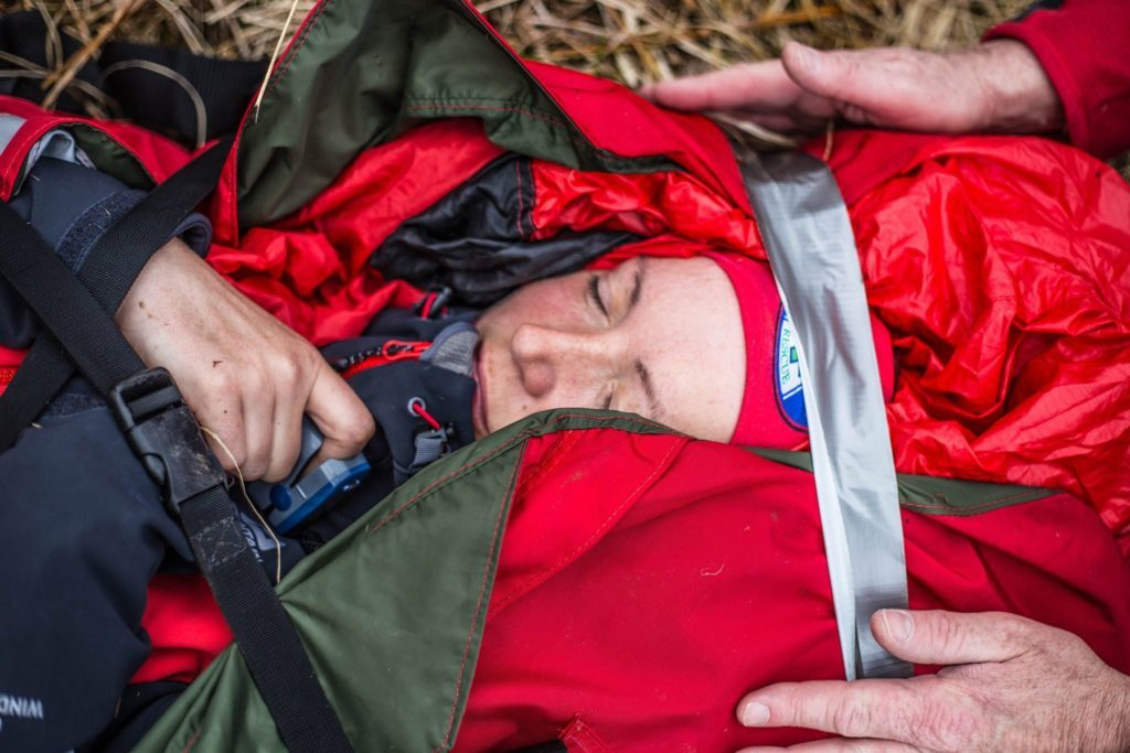 A 'casualty' is strapped to a stretcher which is then ready to be carried down the mountain.