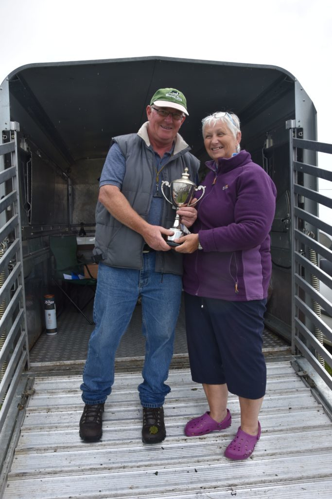 Phyllis Picken presents Iain McConnell with the AH Miller trophy for the highest pointed outrun, lift and fetch.
