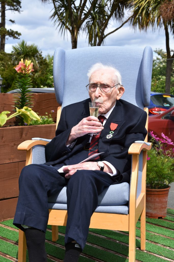 Norris Gilbert enjoys a glass of champagne after staff at Cooriedoon Care Home celebrated the event with drinks and snacks for all of the residents and special visitors.