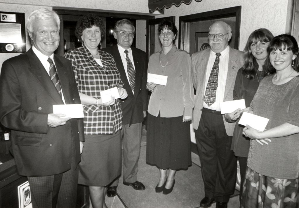 Handing out cheques to worthy causes, outgoing Isle of Arran Rotary Club president Hamish Thomson and new president Jim Henderson presented the awards. Recipients were, l to r, Bill Scott - Lochranza Hall Project, Rev Elizabeth Watson - Whiting Bay Millennium Hall Project, Alison Marr - Arran Highland Dancing Club, Susie Currie -Arran Ladies Hockey Club, Fiona Hamilton - Shiskine Playgroup.