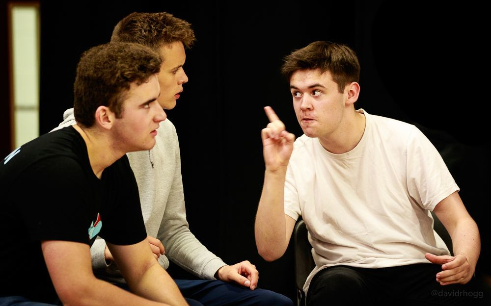Delivering his lines, actor James Smith rehearses with cast members.