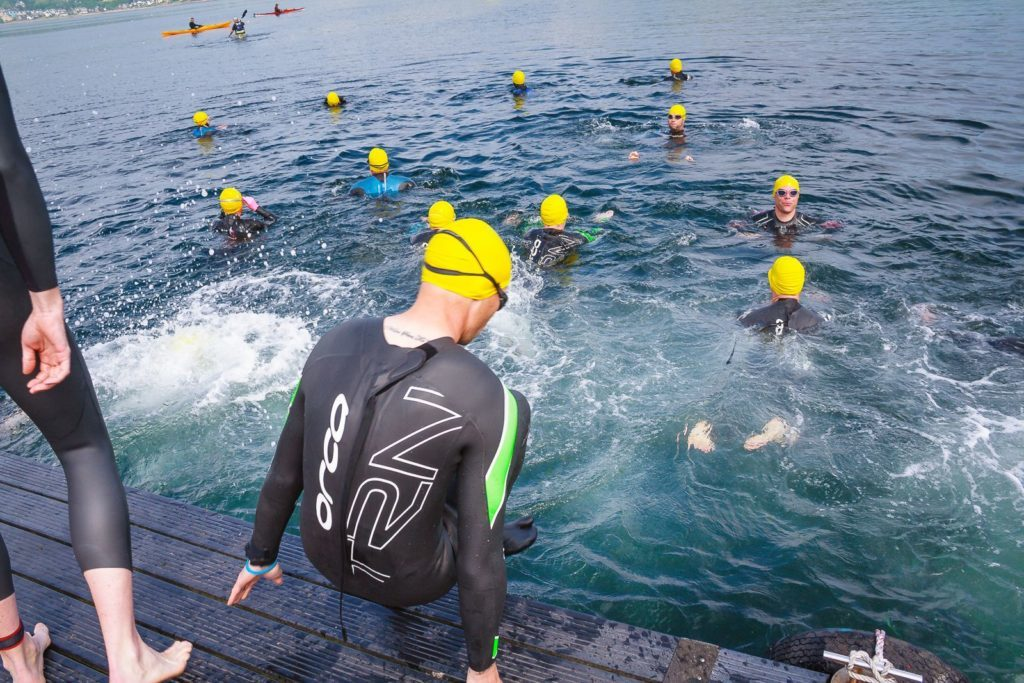 Contestants set off from Holy Isle to swim to Lamlash.