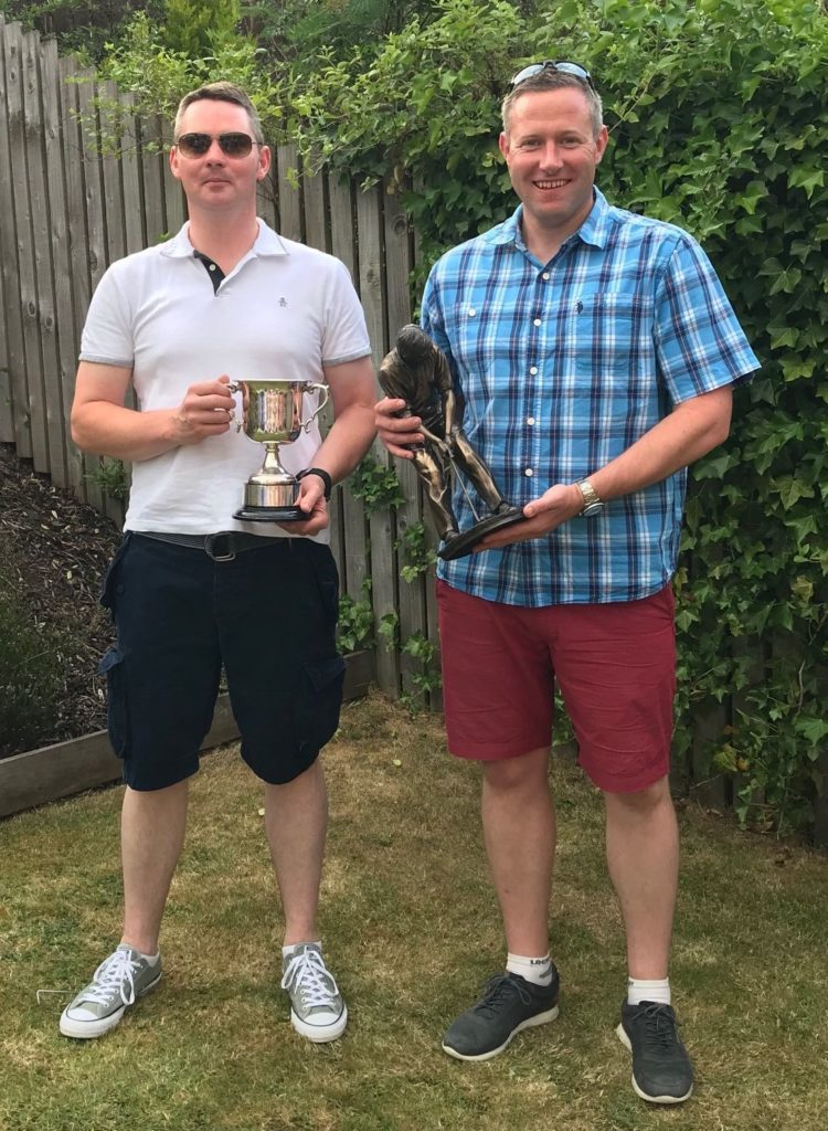Arran Open Champion Craig Young with the Taste of Arran Trophy and Alan Hunter, handicap winner, with the Douglas Hotel Trophy.