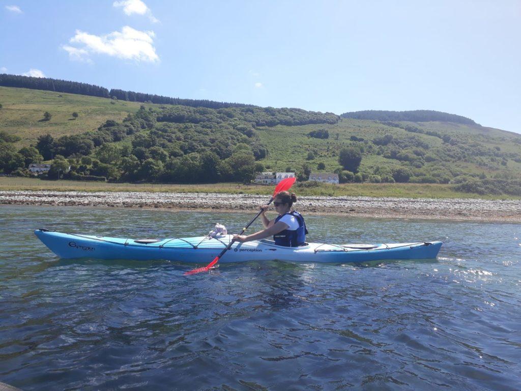 Mary Smyth paddling close to the shoreline off Imachar.