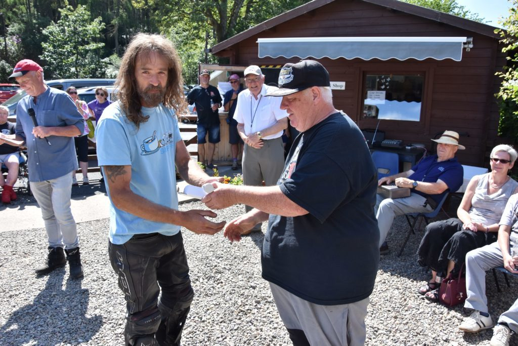 Organiser Lenny Hartley presents Scott Mackenzie with his prize for winning the modern category.