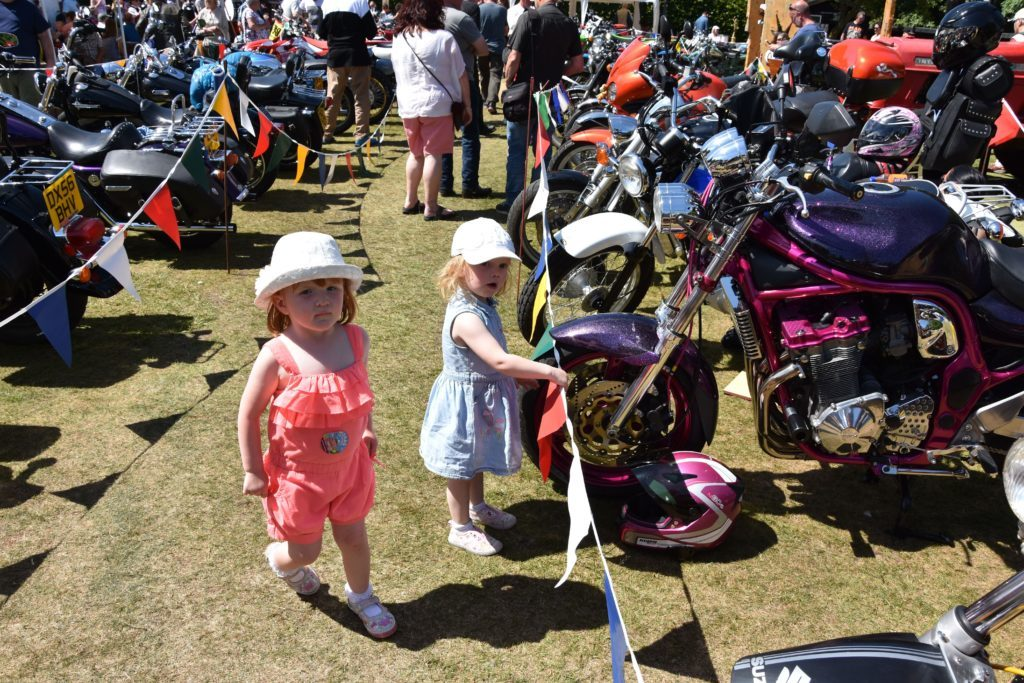 Young and old appreciate the machines, including these two young girls who fancied the sparkly pink and purple bike on display.