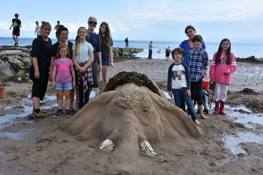 A great team effort by Team Dumbo, which included Bay Queen Greta Litton, who helped create the elephant rising out of the sand.