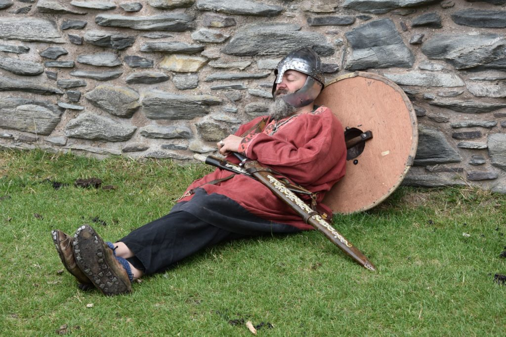 An exhausted Viking takes a break from looting and plundering.