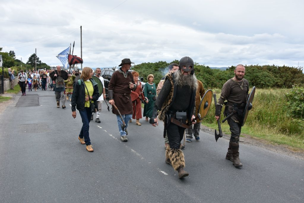 Vikings join the procession to the Village hall.
