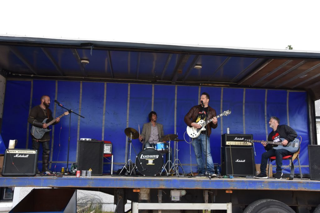 Brown Noise perform classic rock songs during their afternoon performance.