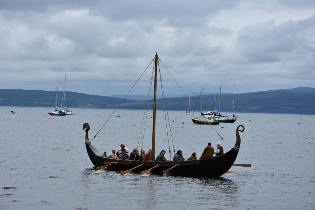 Attacking Vikings make their way along the shore towards the Lochranza Castle.