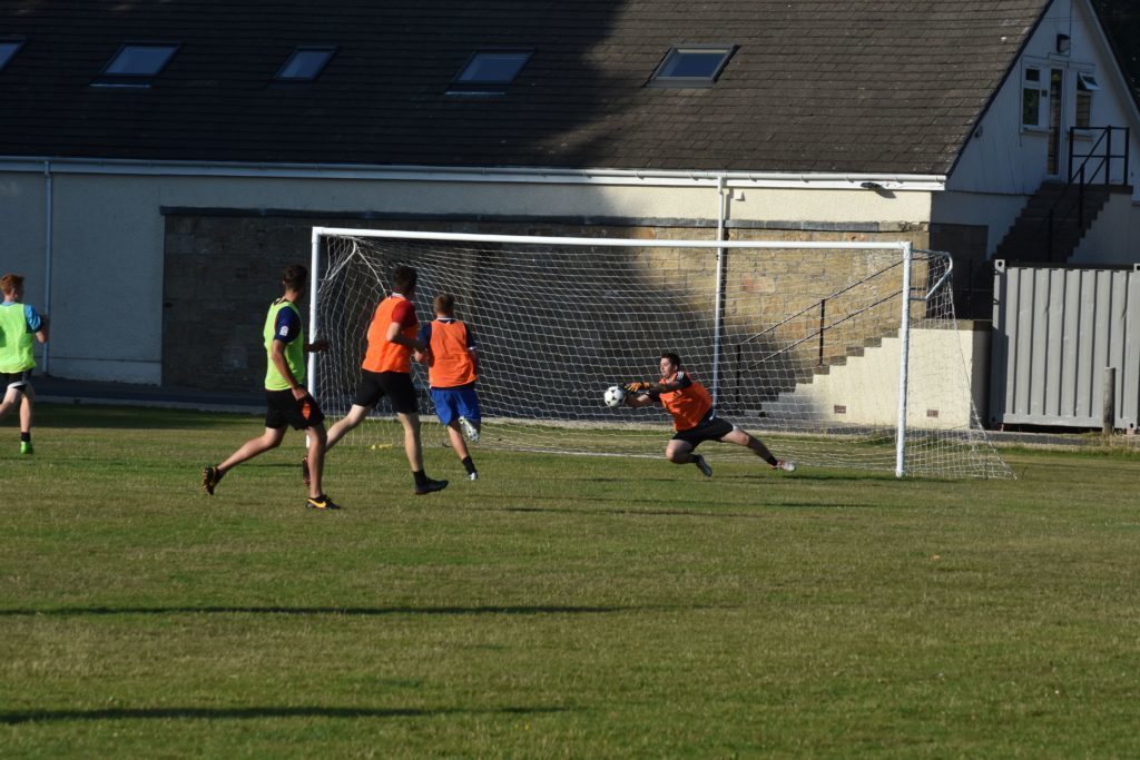 The fast-paced 11-a-side game after the training kept the goalies on both sides very busy.