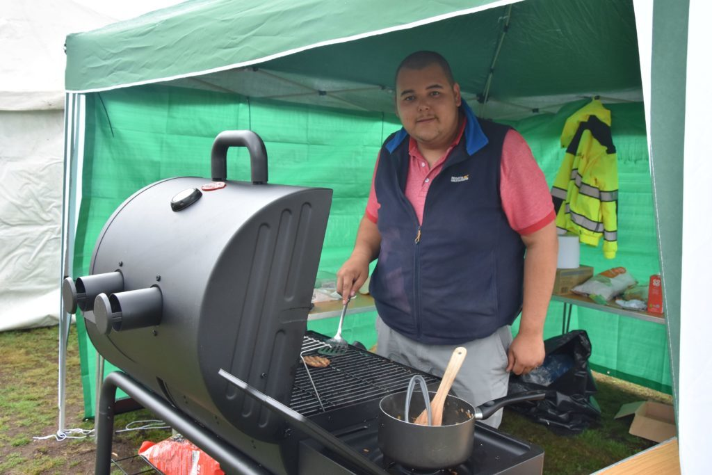 Arran Norton prepared a steady stream of burgers to feed the hungry cricketers.