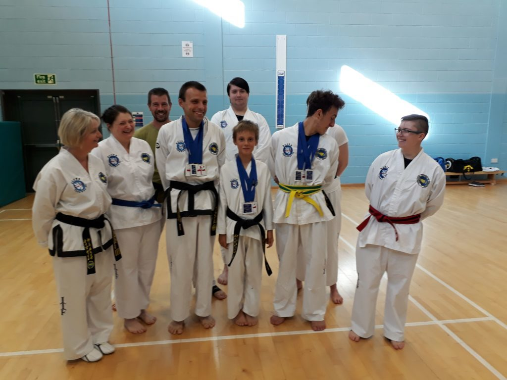 A small group of Taekwon-do students welcome the returning champions back after their success at the European championships.