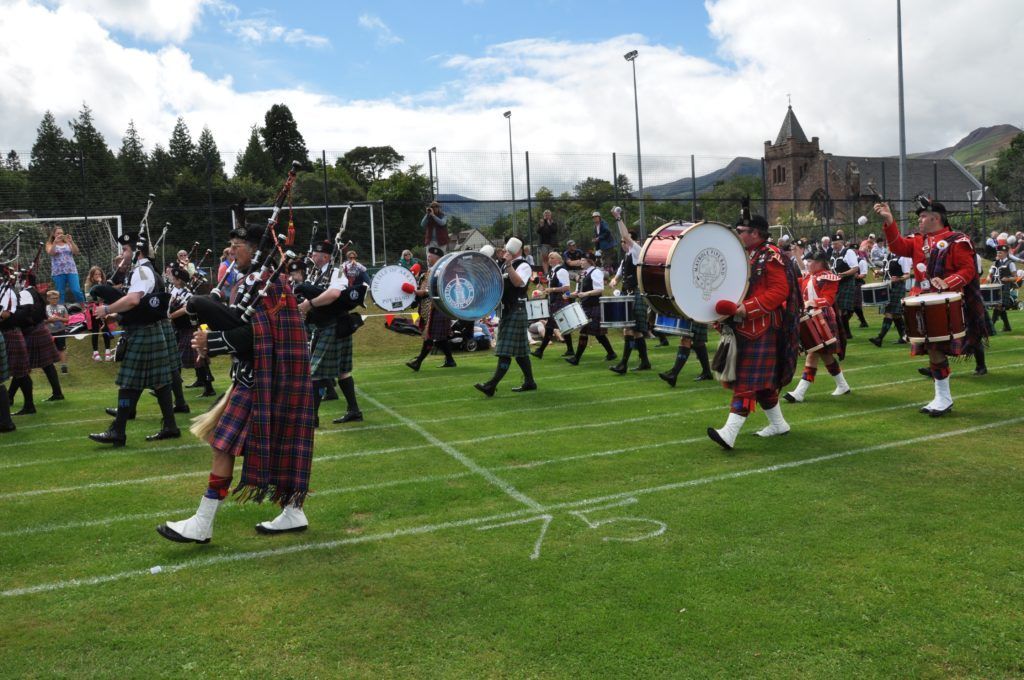 The three big drums of the Arran, Maybole and Kilbarchan pipe bands.