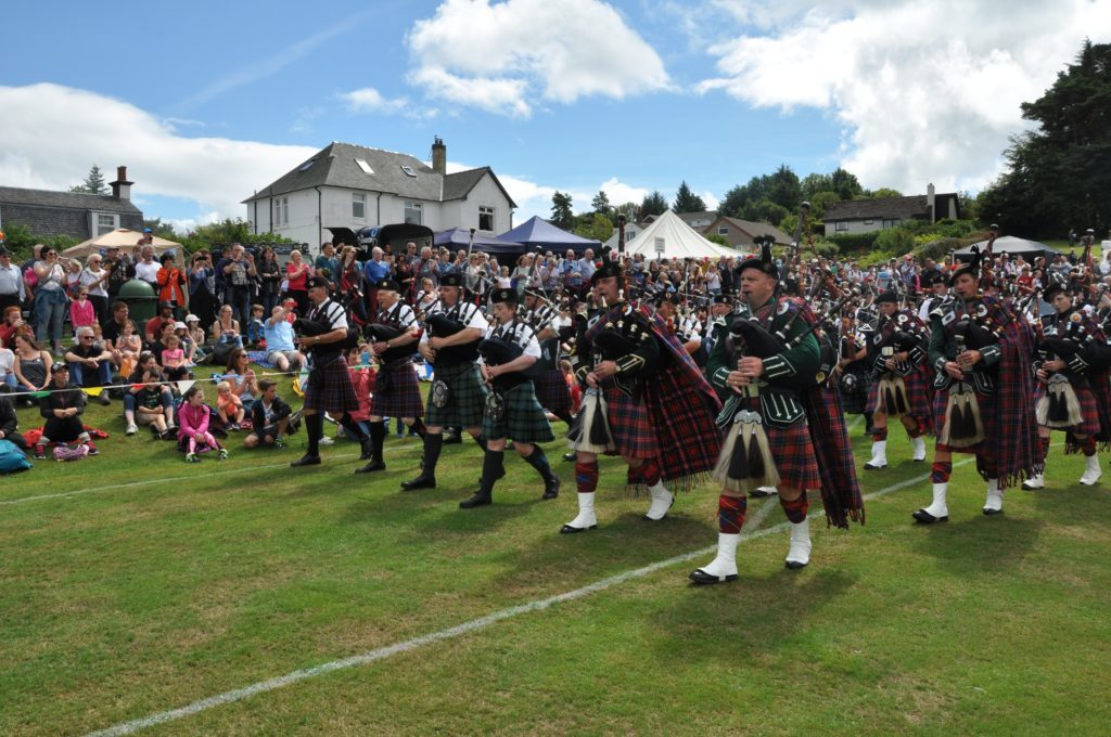 The mass pipe bands play to a big crowd.