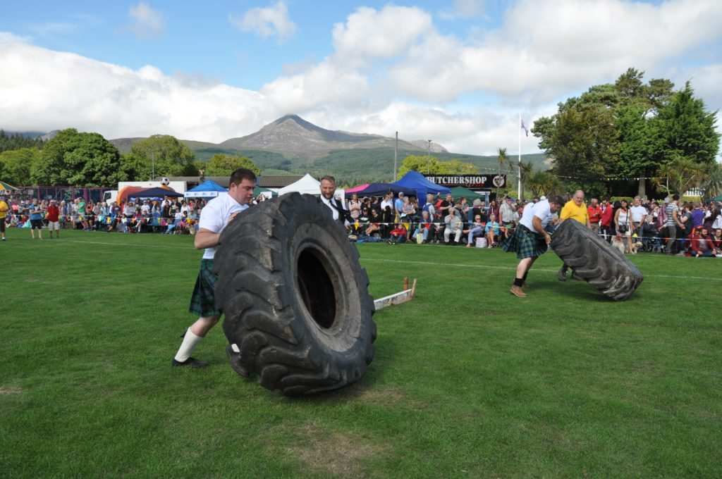 Dr Rory Gilmore (left) and Andrew Earle compete in a flip the tyre heat.