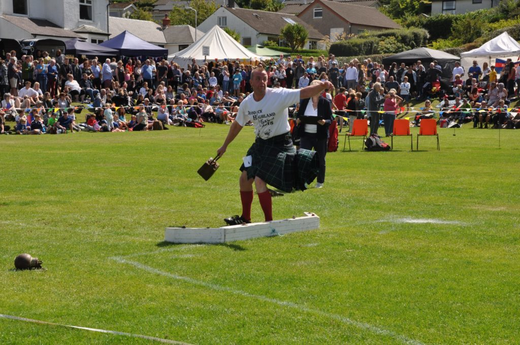 Ernie Weir throws the heavy weight for distance.