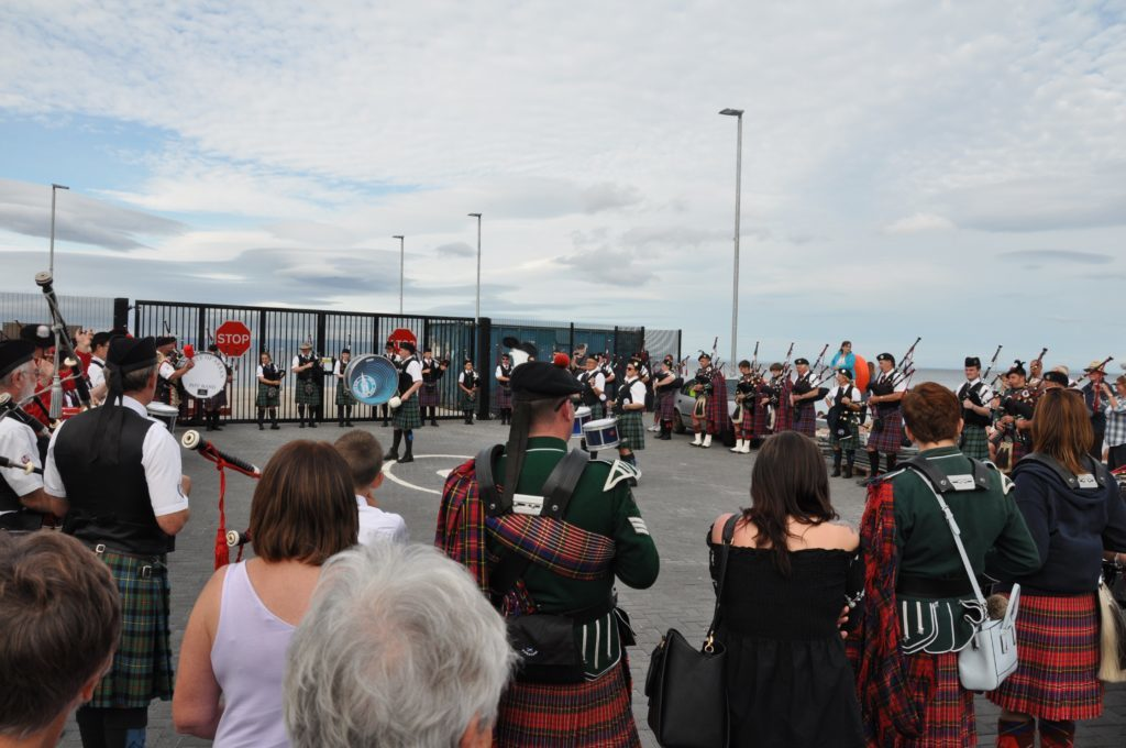 The mass pipe bands beat a retreat at the ferry terminal.