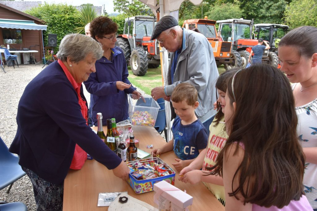 Tombola time, children receive consolation prizes by selecting a treat from the sweetie tin.