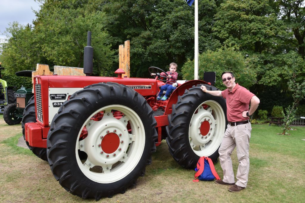 Four year old John and dad Brian Donlin inspect a rare International 634 tractor.