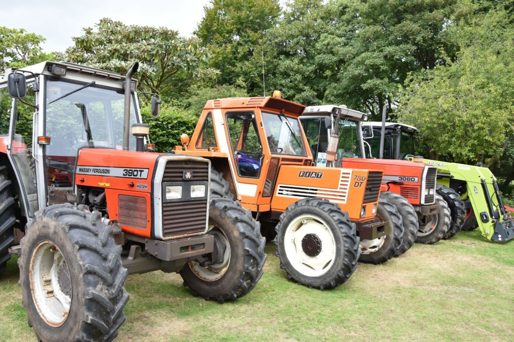 A collection of some of the larger tractors on display.