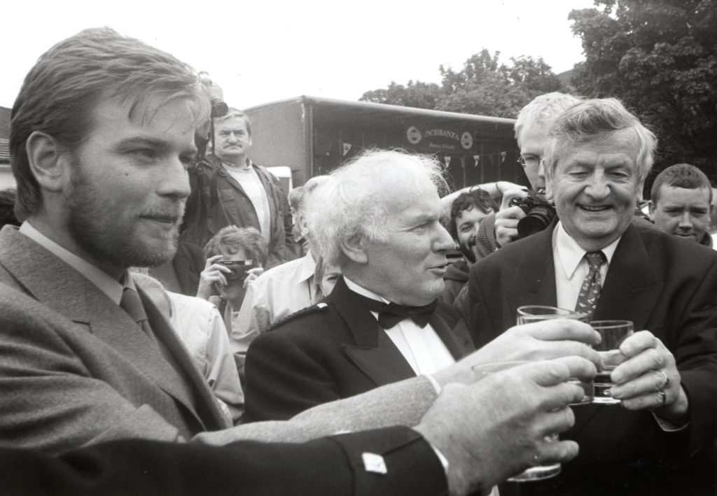 Immediately after opening the first cask Ewan McGregor, Gordon Mitchell and Harold Currie taste the whisky.