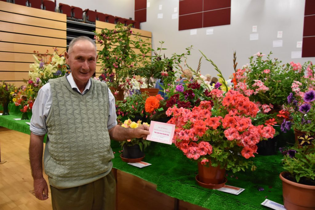 Alastair Hendry with his prize winning geraniums that earned him the Lady Jean Fforde Cup.