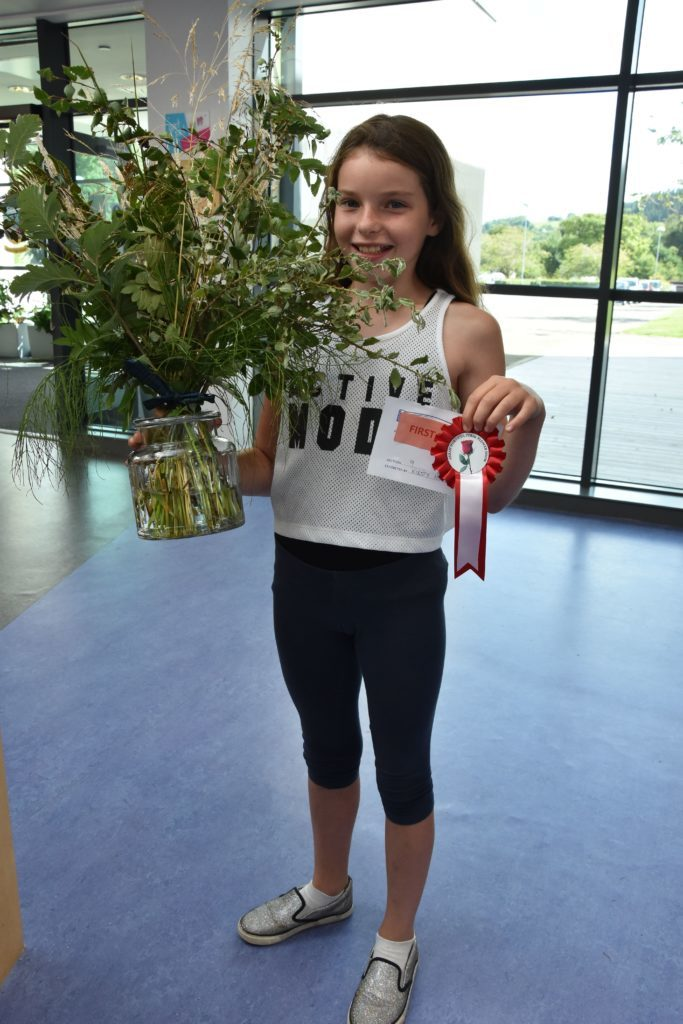 Kirsty Hume was the young winner in the children's category for her arrangement of leaves and grasses.