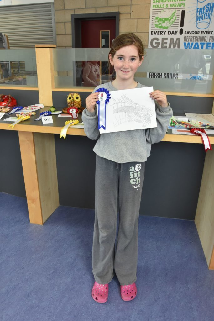 Receiving numerous prizes, Jemma Totty was most proud of her second place drawing of a dragon done in pencil.