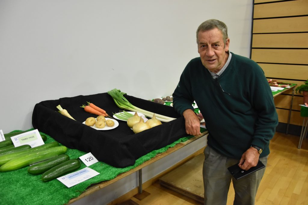 Excelling himself in vegetable growing, John O'Sullivan with his prize winning collection of vegetables.