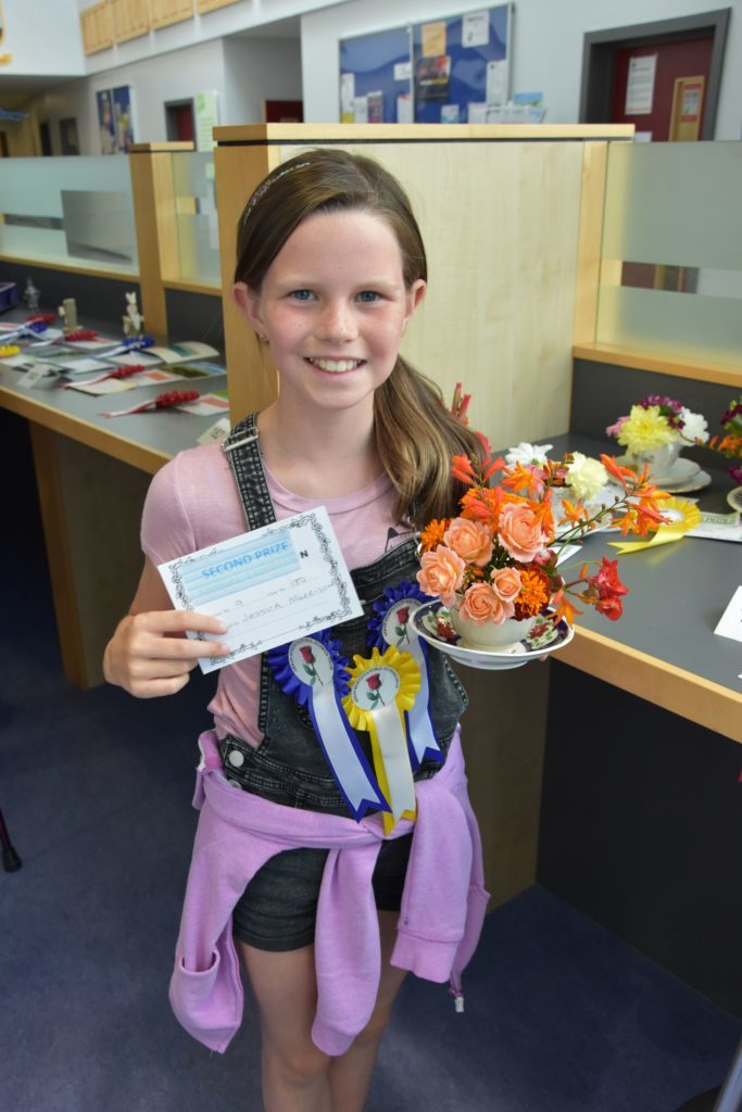 Among numerous prizes, Jessica Morrison was most proud of her bright posy in a teacup which earned her a second place prize.