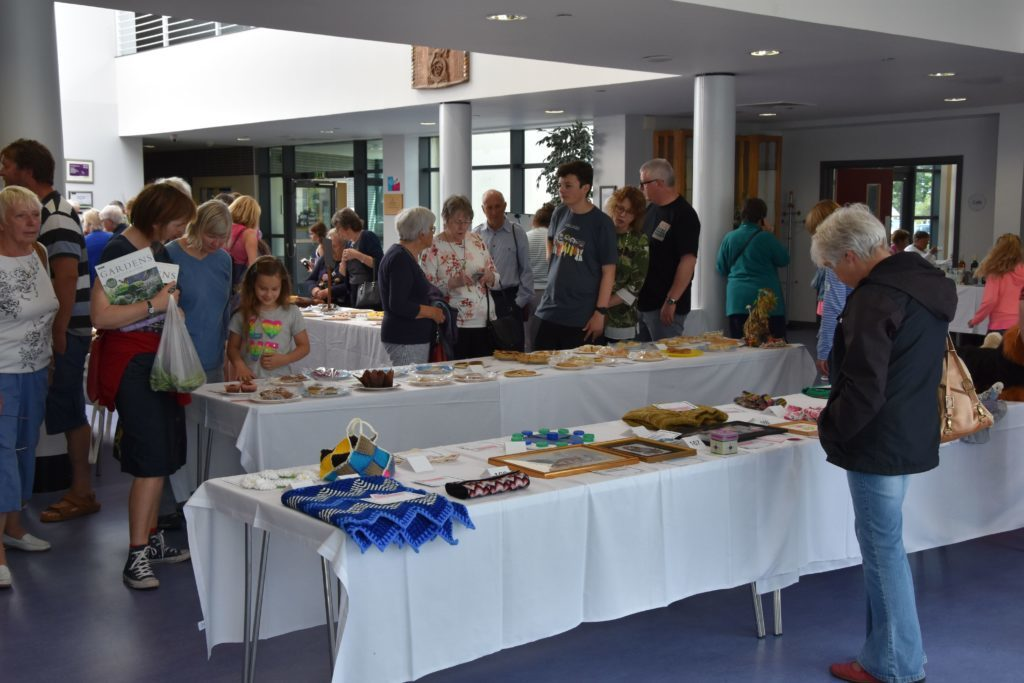 Visitors pack the school cafeteria to inspect the items on display.