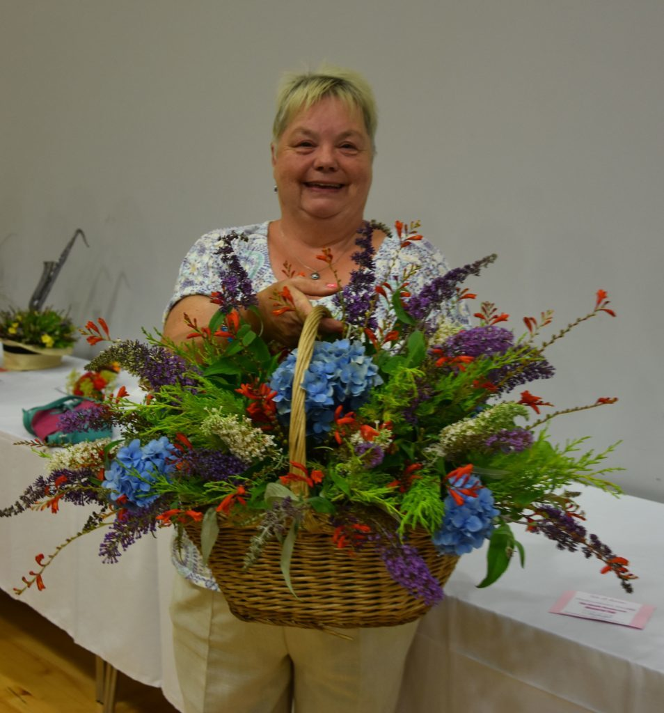 With a natural flair with flowers, May Crawford exhibited her best in class wicker basket of cut flowers.