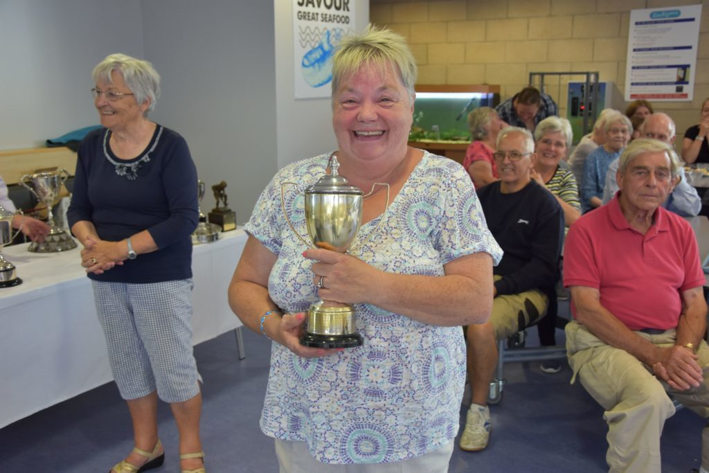 May Crawford with the Rhoda Henderson Memorial Cup for the best exhibit of cut flowers in a wicker basket.
