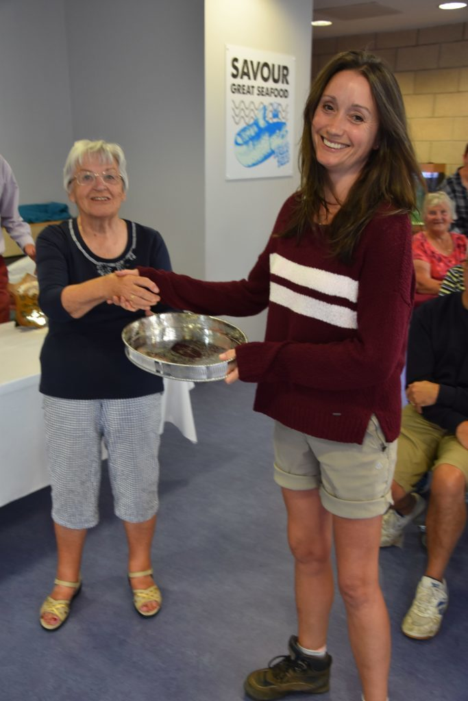 Sarah Crawford receives the FC Henderson Trophy for most points attained in the baking section.
