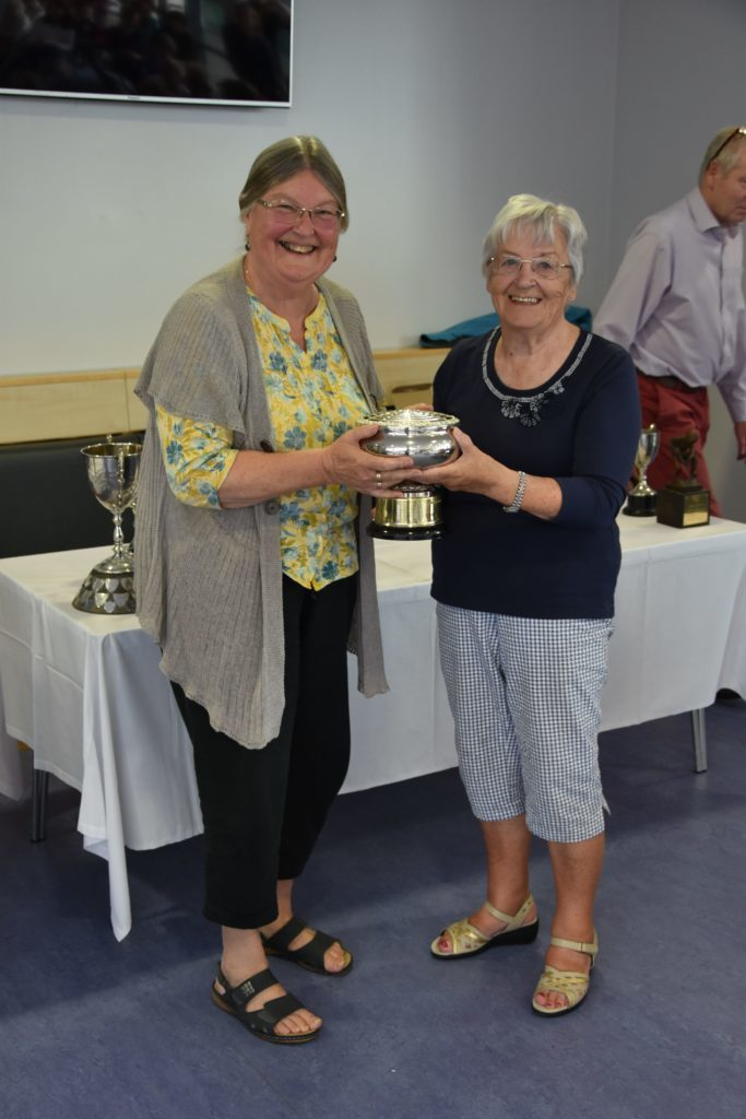 Angela Cassels receives the Chris Hall Rosebowl for best exhibit in the handcraft section.