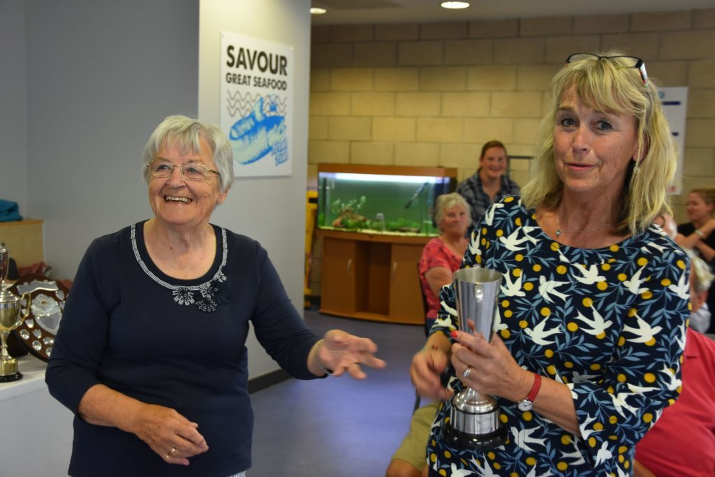 Lesley Lockhart with the Archie Craig Memorial Trophy for best exhibit in the cut flowers section.