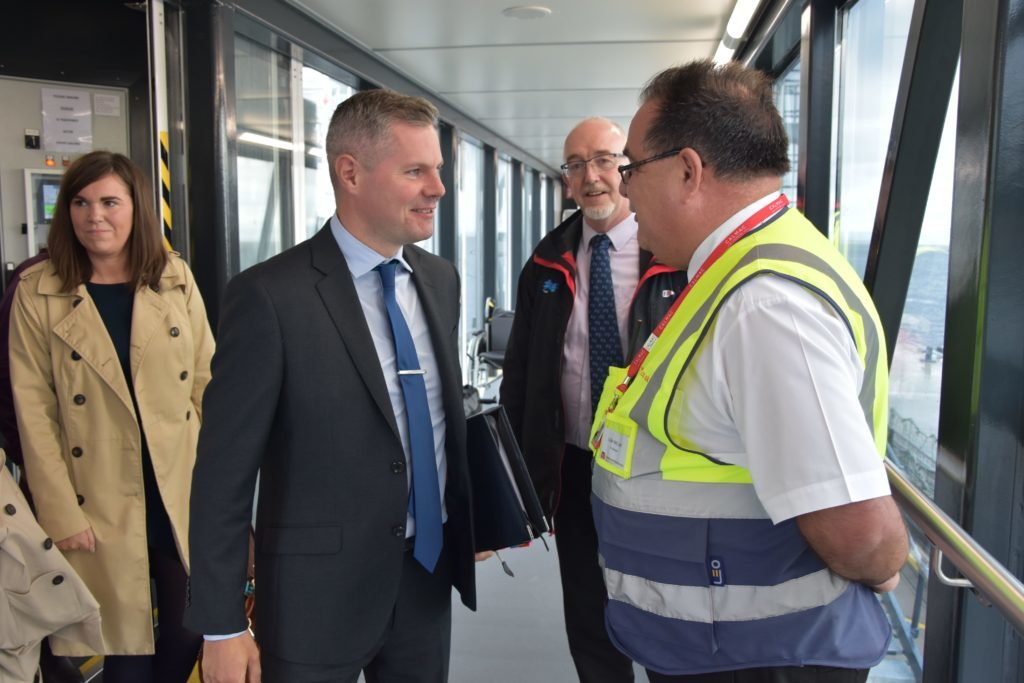 No stranger to Arran, Cabinet Secretary for Finance and the Constitution, Mr Derek Mackay greets CalMac Port Manager Colin McCort.
